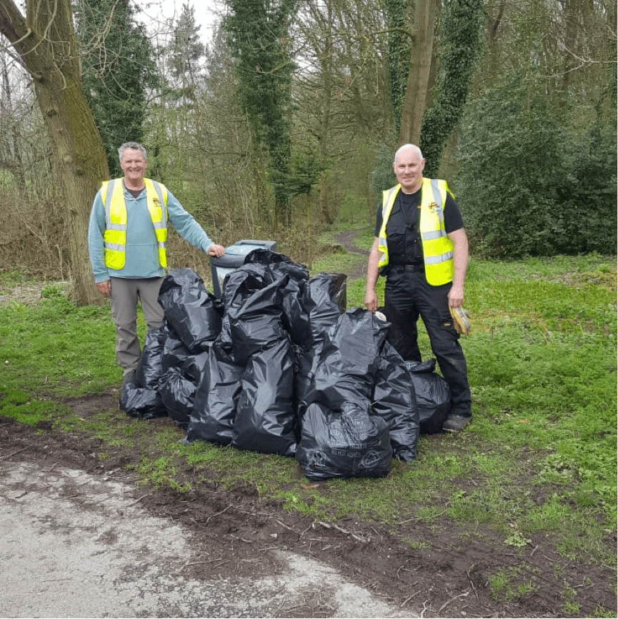 Local councillors standing next to bags of rubbish collected on the litter pick