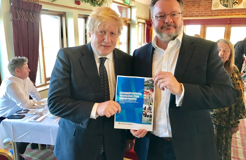 Cllr Lewis with Home Secretary Boris Johnson MP and the manifesto